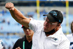 Carolina Panthers owner David Tepper celebrates after their win against the New Orleans Saints during an NFL football game Sunday, Sept. 19, 2021, in Charlotte, N.C. (AP Photo/Jacob Kupferman)