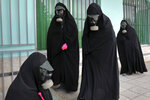 Cleric women wearing protective clothing and