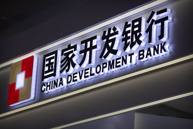The logo for the China Development Bank is seen on a display at the China International Fair for Trade in Services (CIFTIS) in Beijing on Sept. 5, 2020. The former chairman of the main Chinese state bank behind Beijing's initiative to build railways and ports across dozens of Asian countries has been sentenced to life in prison on corruption charges, a court announced. (AP Photo/Mark Schiefelbein)