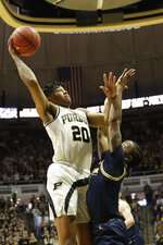 Purdue guard Nojel Eastern (20) shoots over Michigan guard Zavier Simpson (3) during the first half of an NCAA college basketball game, Saturday, Feb. 22, 2020, in West Lafayette, Ind. (Nikos Frazier/Journal & Courier via AP)