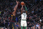 Boston Celtics guard Jaylen Brown (7) shoots over Cleveland Cavaliers center Tristan Thompson, left, during the second half of an NBA basketball game in Boston, Monday, Dec. 9, 2019. The Celtics won 110-88. (AP Photo/Charles Krupa)
