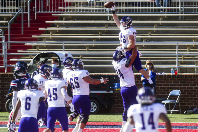 Western Carolina tightens Clayton Bardall (86) celebrates his touchdown with teammates during the first half of an NCAA football game on Saturday, Nov. 14, 2020, in Lynchburg, Va. (AP Photo/Shaban Athuman)