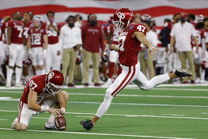 Oklahoma's Spencer Jones (87) holds as Gabe Brkic (47) kicks a field goal against Florida during the second half of the Cotton Bowl NCAA college football game in Arlington, Texas, Wednesday, Dec. 30, 2020. (AP Photo/Ron Jenkins)