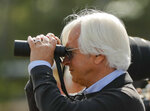 Trainer Bob Baffert watches Triple Crown hopeful Justify workout at Belmont Park, Friday, June 8, 2018, in Elmont, N.Y. Justify will attempt to become the 13th Triple Crown winner when he races in the 150th running of the Belmont Stakes horse race on Saturday. (AP Photo/Julie Jacobson)