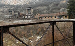 In this photo taken on Thursday, Jan. 23, 2020, an abandoned factory is seen near the town of Kucevo, Serbia. Near-empty villages with abandoned, crumbling houses can be seen all over Serbia — a clear symptom of a shrinking population that is raising acute questions over the economic well-being of the country. The decline is happening so fast it's considered a national emergency and the United Nations has stepped in to help. (AP Photo/Darko Vojinovic)