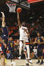 Oregon State's Stephen Thompson Jr. (1) drives to the basket despite defense from California's Justice Sueing (10) during the second half of an NCAA college basketball game in Corvallis, Ore., Saturday, Feb. 9, 2019. Oregon State won, 79-71. (AP Photo/Amanda Loman)