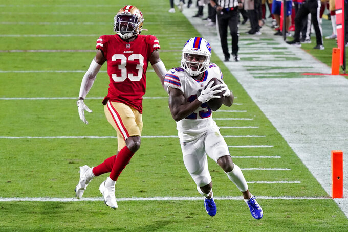 Buffalo Bills wide receiver Isaiah McKenzie (19) scores a touchdown as San Francisco 49ers defensive back Tarvarius Moore (33) defends during the second half of an NFL football game, Monday, Dec. 7, 2020, in Glendale, Ariz. (AP Photo/Ross D. Franklin)
