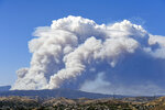 A large header forms from a brush fire which has started up near Lake Hughes Road in Castaic, north of Santa Clarita, Calif., Wednesday, Aug. 12, 2020. (David Crane/The Orange County Register/SCNG via AP)
