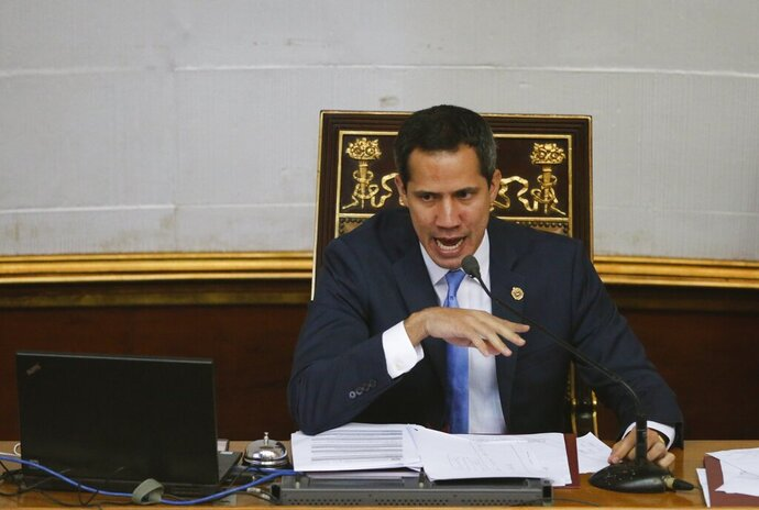 Venezuelan opposition leader and self-proclaimed interim president of Venezuela Juan Guaido speaks during a weekly session at the National Assembly in Caracas, Venezuela, Tuesday, Sept. 17, 2019. Venezuela's opposition-led congress has again thrown its support behind Guaidó, saying he'll serve as the crisis-wracked nation's interim president until they've ended Nicolás Maduro's grip on power. (AP Photo/Ariana Cubillos)