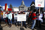 Angela Jenners, center, a teacher at Bear Valley International School, leads fellow picketers in a chant during a strike rally in front of the state Capitol, Monday, Feb. 11, 2019, in Denver. The strike is the first for teachers in Denver since 1994 and centers on base pay. (AP Photo/David Zalubowski)
