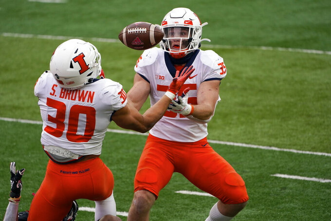 Illinois linebacker Jake Hansen (35) intercepts a Nebraska pass as defensive back Sydney Brown (30) reaches out during the second half of an NCAA college football game in Lincoln, Neb., Saturday, Nov. 21, 2020. Illinois won 41-23. (AP Photo/Nati Harnik)
