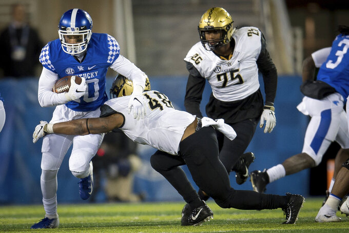 Kentucky running back Asim Rose (10) is tackled by Vanderbilt linebacker Jordan Griffin (40) during the second half of an NCAA college football game in Lexington, Ky., Saturday, Oct. 20, 2018. Kentucky won, 14-7. (AP Photo/Bryan Woolston)