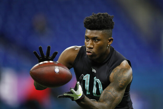 FILE - In this March 1, 2020, file photo, TCU defensive back Jeff Gladney runs a drill at the NFL football scouting combine in Indianapolis. Gladney was chosen by the Minnesota Vikings in the first round of the NFL draft. (AP Photo/Charlie Neibergall, File)