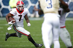 Georgia running back D'Andre Swift (7) moves the ball in the first half of an NCAA football game between Georgia and Georgia Tech on Saturday, Nov. 30, 2019, in Atlanta. (Joshua L. Jones/Athens Banner-Herald via AP)