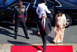 Sri Lankan President Gotabaya Rajapaksa, center, and the first lady Ayoma Rajapaksa, right, arrive at the parliament to address the ceremonial inauguration of the session in Colombo, Sri Lanka, Friday, Jan. 3, 2020. (AP Photo/Eranga Jayawardena)