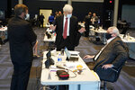 Virginia State Senate Majority Leader, Sen. Richard Saslaw, center, along with Sen. John Cosgrove, R-Chesapeake, left, talk with new Sen. Travis Hackworth, R-Tazewell, during the Senate reconvene session at the Science Museum of Virginia in Richmond, Va., Wednesday, April 7, 2021. Hackworth replaced Sen. Chafin who died earlier this year. (AP Photo/Steve Helber)