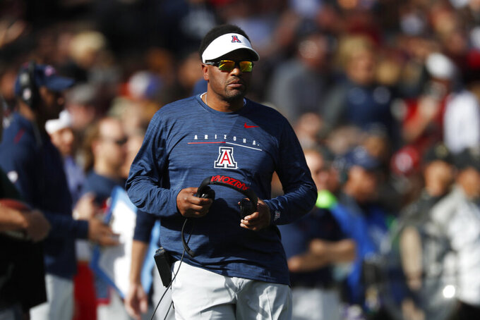 FILE - In this Oct. 5, 2019, file photo, Arizona coach Kevin Sumlin watches during the first half of the team's NCAA college football game against Colorado in Boulder, Colo. Sumlin and Arizona travel to Salt Lake City to play Utah in their season opener. (AP Photo/David Zalubowski, File)