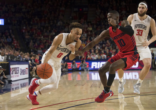 Richmond guard Jacob Gilyard (0) drives around Dayton defender Jalen Crutcher (10) during the first half of an NCAA college basketball game in Richmond, Va., Saturday, Jan. 25, 2020.(AP Photo/Lee Luther Jr.)
