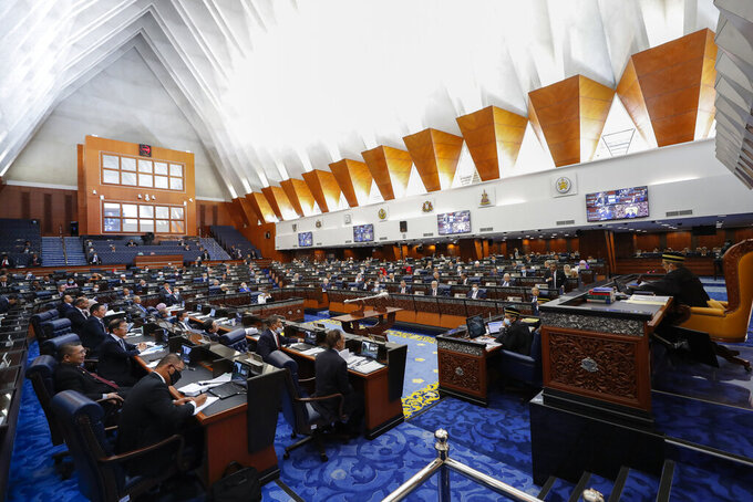Malaysia's members of parliament attend a session of the lower house of parliament in Kuala Lumpur, Malaysia, Monday, July 13, 2020. (AP Photo/Vincent Thian)
