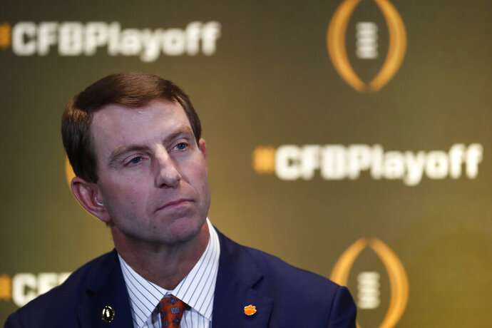 Clemson head coach Dabo Swinney speaks during a news conference ahead for the College Football playoffs Thursday, Dec. 12, 2019, in Atlanta. Ryan Day of Ohio State was unable to attend. (AP Photo/John Bazemore)