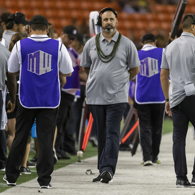 Hawaii head coach Nick Rolovich glances up at the score board in the first half of an NCAA college football game against Utah State, Saturday, Nov. 3, 2018, in Honolulu. (AP Photo/Eugene Tanner)