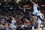 Los Angeles Clippers forward Montrezl Harrell (5) drives to the basket past Miami Heat guard Tyler Herro (14) and forward Derrick Jones Jr. (5) during the first half of an NBA basketball game, Friday, Jan. 24, 2020, in Miami. (AP Photo/Lynne Sladky)