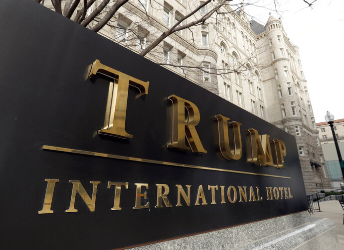 FILE - In this Dec. 21, 2016, file photo, The Trump International Hotel at 1100 Pennsylvania Avenue NW, is photographed in Washington. America's vaping industry has taken its fight to fend off regulation directly to President Donald Trump's doorstep, with a lobbying group twice booking meetings at his Washington hotel. (AP Photo/Alex Brandon, File)