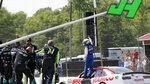 A.J. Allmendinger celebrates on the track after winning the B&L Transport 170 NASCAR Xfinity Series auto race at Mid-Ohio Sports Car Course on Saturday, June 5, 2021, in Lexington, Ohio. (AP Photo/Tom E. Puskar)