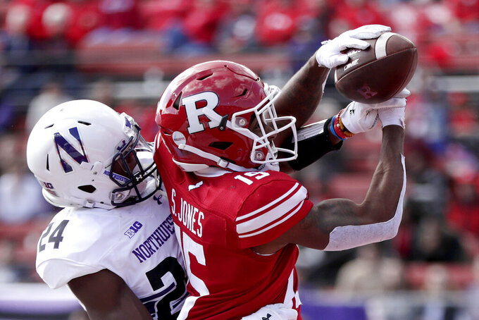 "FILE - In this Oct. 20, 2018 file photo, Northwestern cornerback Montre Hartage, left, deflects a pass as Rutgers wide receiver Shameen Jones tries to make the catch in the end zone during the second half of an NCAA college football game in Piscataway, N.J. New Jersey's flagship university has asked a high school in northern Louisiana to change its logo because it's identical to the block ""R'' that Rutgers has trademarked. (AP Photo/Julio Cortez, File)"