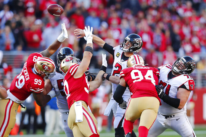 Atlanta Falcons quarterback Matt Ryan (2) passes as San Francisco 49ers defensive tackle DeForest Buckner (99), defensive end Nick Bosa (97) and defensive end Solomon Thomas (94) apply pressure during the first half of an NFL football game in Santa Clara, Calif., Sunday, Dec. 15, 2019. (AP Photo/John Hefti)