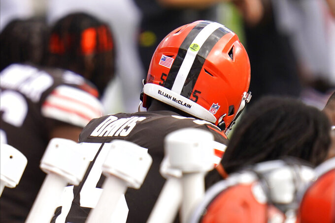 The name of Elijah McClain, a man killed by police in Colorado, is seen on the back of the helmet worn by Cleveland Browns linebacker Tae Davis as he sits on the bench during the second half of an NFL football game against the Baltimore Ravens, Sunday, Sept. 13, 2020, in Baltimore. The Ravens won 38-6. (AP Photo/Julio Cortez)