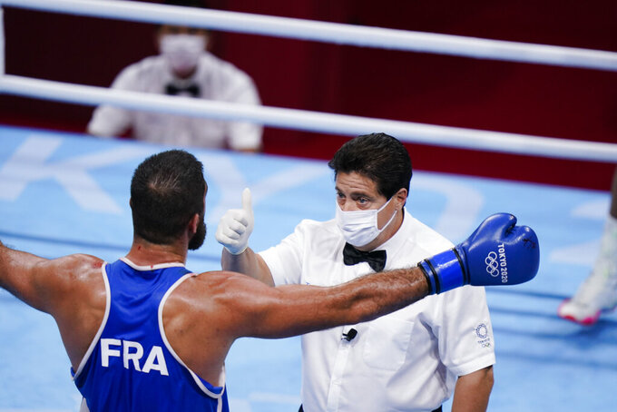 Eliad Mourad, of France reacts as he is disqualified by the referee during a men's super heavyweight over 91-kg boxing match against Britain's Frazer Clarke at the 2020 Summer Olympics, Sunday, Aug. 1, 2021, in Tokyo, Japan. (AP Photo/Frank Franklin II)