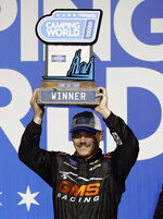 Brett Moffitt holds up the trophy in Victory Lane after winning the NASCAR Truck Series auto race at Chicagoland Speedway in Joliet, Ill., Friday, June 28, 2019. (AP Photo/Nam Y. Huh)