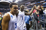 Duke guard Tre Jones (3) and forward Zion Williamson (1) celebrate as they leave the court after the team's NCAA men's college basketball tournament East Region semifinal against Virginia Tech in Washington, Friday, March 29, 2019. Duke won 75-73. (AP Photo/Alex Brandon)