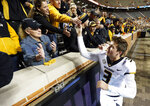 Missouri quarterback Drew Lock (3) celebrates with fans after his team defeated Tennessee 50-17 in an NCAA college football game Saturday, Nov. 17, 2018, in Knoxville, Tenn. (AP Photo/Wade Payne)
