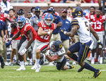 Mississippi quarterback John Rhys Plumlee (10) escapes the grasp of California linebacker Evan Weaver (89) at Vaught-Hemingway Stadium in Oxford, Miss. on Saturday, September 21, 2019. California won 28-20. (Bruce Newman, Oxford Eagle via AP) (Bruce Newman/Oxford Eagle via AP)