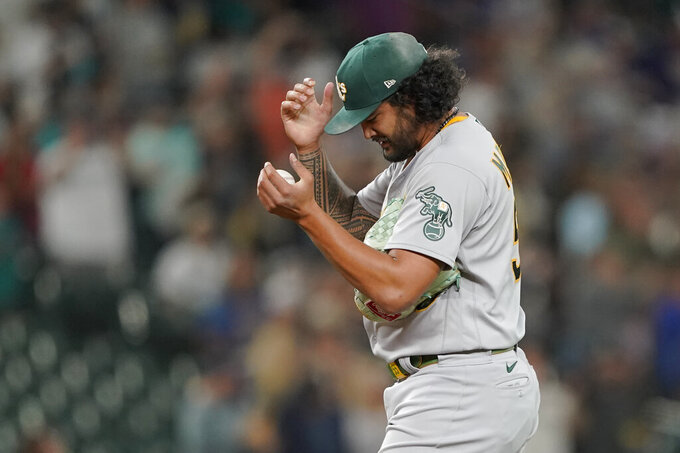 Oakland Athletics starting pitcher Sean Manaea pauses after he gave up a solo home run to Seattle Mariners' Tom Murphy during the seventh inning of a baseball game Thursday, July 22, 2021, in Seattle. (AP Photo/Ted S. Warren)