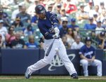 Milwaukee Brewers' Keston Hiura hits an RBI double during the sixth inning of a baseball game against the Atlanta Braves Wednesday, July 17, 2019, in Milwaukee. (AP Photo/Morry Gash)