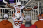 Texas running back Bijan Robinson (5) celebrates a touchdown with teammate Jake Majors (65) during the second half of an NCAA college football game against Kansas State in Manhattan, Kan., Saturday, Dec. 5, 2020. (AP Photo/Orlin Wagner)