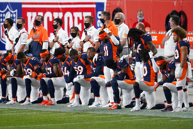 Some of the Denver Broncos kneel during the national anthem prior to an NFL football game against the Tennessee Titans, Monday, Sept. 14, 2020, in Denver. (AP Photo/Jack Dempsey)