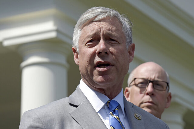 FILE - In this May 3, 2017, file photo, Rep. Fred Upton, R-Mich., left, speaks to reporters outside the White House in Washington. Upton announced Monday, Feb. 24, 2020 he will seek re-election to his Sixth Congressional District seat located in the southwest corner of the state. In announcing his bid for an 18th term, Upton said there is