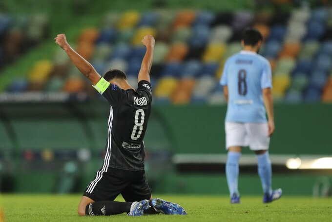 Lyon's Houssem Aouar reacts at the end of the Champions League quarterfinal soccer match between Lyon and Manchester City at the Jose Alvalade stadium in Lisbon, Portugal, Saturday, Aug. 15, 2020. Lyon won the match 3-1. (Miguel A. Lopes/Pool via AP)