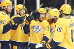 Nashville Predators right wing Viktor Arvidsson (33), of Sweden, is congratulated after scoring a goal against the Ottawa Senators in the second period of an NHL hockey game Tuesday, Feb. 25, 2020, in Nashville, Tenn. (AP Photo/Mark Humphrey)
