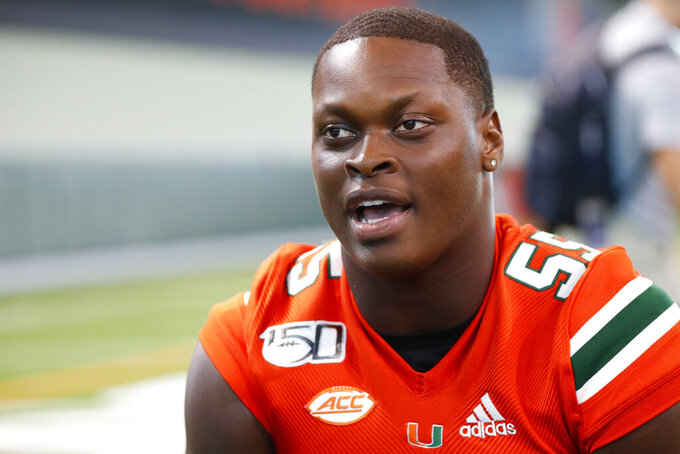 FILE - In this Aug. 13, 2019, file photo, Miami linebacker Shaquille Quarterman speaks to members of the media during the team's Media Day in Coral Gables, Fla. Quarterman thought about the NFL draft earlier this year, before deciding to return to Miami for one simple reason. The team's best linebacker feels like he hasn't left a big enough mark on the Hurricanes yet. (AP Photo/Wilfredo Lee, File)