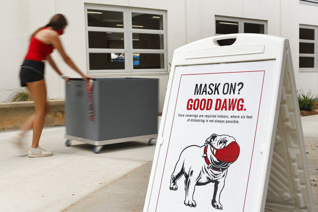 University of Georgia undergraduate students move into Brumby Hall one week before the start of the fall semester during the coronavirus pandemic on Friday, Aug. 14, 2020. (Joshua L. Jones/Athens Banner-Herald via AP)