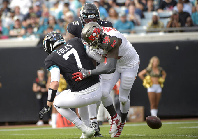 FILE - In this Dec. 1, 2019, file photo, Tampa Bay Buccaneers linebacker Shaquil Barrett forces a fumble on a sack of Jacksonville Jaguars quarterback Nick Foles (7) during the first half of an NFL football game in Jacksonville, Fla. The Tampa Bay linebacker has to prove he's not a one-year wonder after leading the NFL with 19 1/2 sacks. (AP Photo/Phelan M. Ebenhack, File)