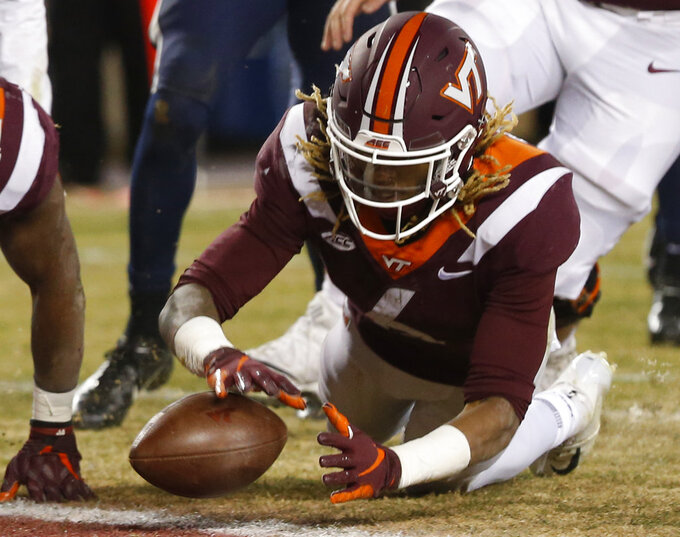 Virginia Tech wide receiver Hezekiah Grimsley (6) recovers a fumble in the end zone for a touchdown during the second half of an NCAA college football game against Virginia in Blacksburg, Va., Friday, Nov. 23, 2018. Virginia Tech won 34-31 in overtime. (AP Photo/Steve Helber)