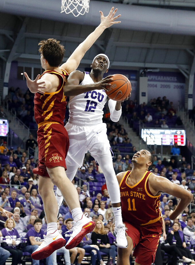 Iowa State forward Michael Jacobson, left, and guard Talen Horton-Tucker (11) defend as TCU forward Kouat Noi (12) of Australia goes up for a shot in the second half of an NCAA college basketball game in Fort Worth, Texas, Saturday, Feb. 23, 2019. (AP Photo/Tony Gutierrez)