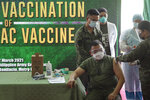 Philippine Army commander, Lt. Gen. Jose Faustino Jr., front left, is injected with the Sinovac vaccine from China during the start of vaccination at Fort Bonifacio, Metro Manila, Philippines on Tuesday, March 2, 2021. The Philippines launched a vaccination campaign to contain one of Southeast Asia's worst coronavirus outbreaks but faces supply problems and public resistance, which it hopes to ease by inoculating top officials. (AP Photo/Aaron Favila)