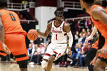 Stanford guard Daejon Davis (1) dribbles the ball during the first half of the team's NCAA college basketball game against Oregon State on Thursday, Jan. 30, 2020, in Stanford, Calif. (AP Photo/John Hefti)